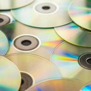 Geschichte der Musikproduktion - Bild eines Stapels Compact Discs (CDs)